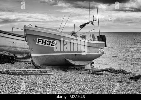 Fishing boat on the beach at Beer (Sidmouth), Dorset UK. Shot in Black & White - Stock Photo