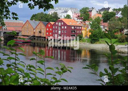 Beautiful view on old houses on stelts at Nedelva river in Trondheim, Norway - Stock Photo