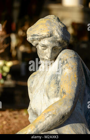 bronze sculpture of woman at historical monumental Staglieno Cemetery in town, shot in bright  winter light  in - Stock Photo