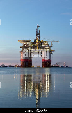 'Big Foot'  Chevron's Deep Ocean Platform departs from Kiewit,  oil & natural gas drill rig, at dawn, departed Ingleside - Stock Photo