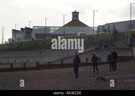 Sunday Family Walk along Aberdeen Beach with the Promenade and Beach ballroom in the Background. North East Scotland, - Stock Photo