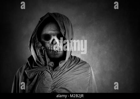 Grim reaper in the dark - Stock Photo