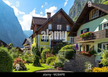HALLSTATT, AUSTRIA - SEPTEMBER 14, 2016 : Hallstatt village with historic mountain houses around, among Alp Mountains - Stock Photo