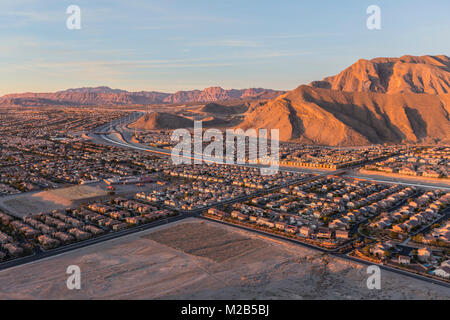 Early morning view of new neighborhoods and Route 215 from the top of Lone Mountain in Northwest Las Vegas. - Stock Photo