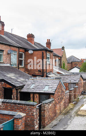 Outbuildings and enclosed back yards at the rear of terraced houses in Whaley Bridge, Derbyshire. When originally - Stock Photo