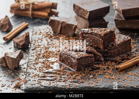 homemade chocolate brownies on dark grey background - Stock Photo