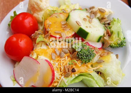 green side salad with cheese dressing - Stock Photo