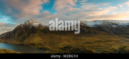 Snow on Tryfan illuminated by the late evening sun, Llyn Ogwen, Snowdonia National Park, Wales - Stock Photo