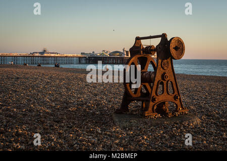 Old Boat Winch on Brighton beach in the winter - Stock Photo