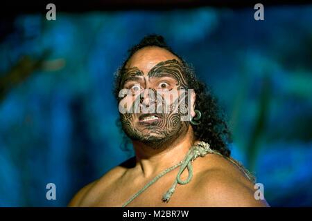 New Zealand, North Island, Rotorua, Show of Maori culture at the Mitai Maori Village. Haka war dance. - Stock Photo