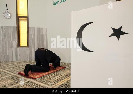 A member of the Ahmadiyya Muslim Community in Israel pray at Mahmood mosque in Kababir, a neighbourhood on Mount - Stock Photo