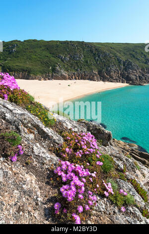 the secluded cove at porthcurno in cornwall, england, uk. - Stock Photo
