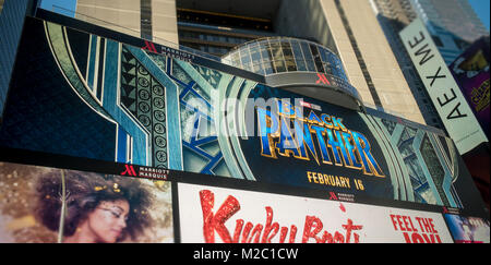 Advertising for the Marvel Studios film 'Black Panther' on a giant digital screen in Times Square in New York on - Stock Photo