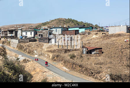 Schoolgirls in road near town on way from Mawsynram to Shillong, Meghalaya, India - Stock Photo