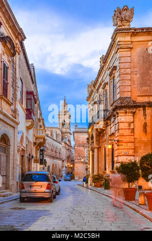 Victoria, Gozo, Malta: Narrow streets of the citadella at the sunset time. - Stock Photo