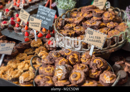 Salted caramel brownies on sale at food festival, Abergavenny, Wales, UK - Stock Photo