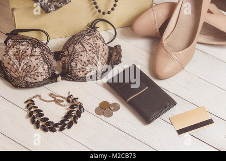 purse, coins, women clothing and accessories after shopping on wooden background. - Stock Photo