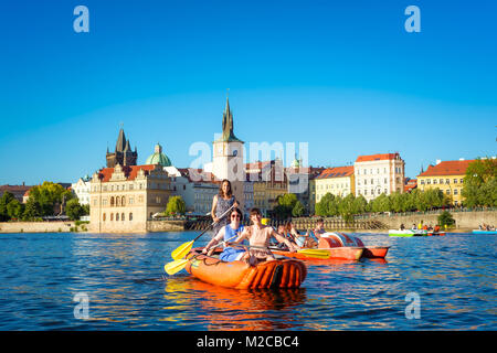 PRAGUE, CZECH REPUBLIC - MAY 27, 2017: Girls kayaking on the river Vltava. - Stock Photo