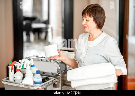 Chambermaid in the hotel corridor - Stock Photo