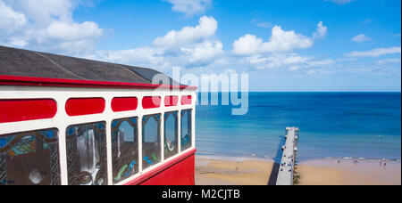 View over Saltburn beach and pier from cliff tramway on top promenade. Saltburn by the sea, North Yorkshire, England. - Stock Photo