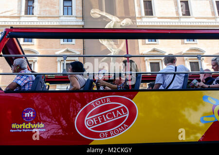 Tourist sightseeing red double decker bus passing in front of Palazzo Massimo alle Terme, National Roman Museum. - Stock Photo