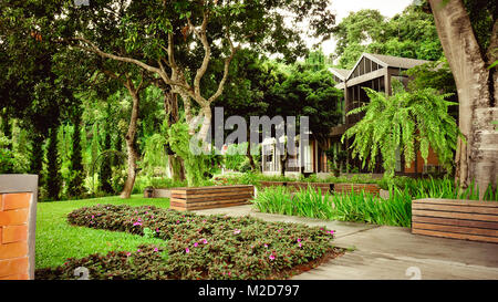 The garden is decorated in tropical jungle style for relaxation. - Stock Photo