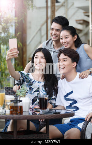 Young people take pictures with their cell phones - Stock Photo