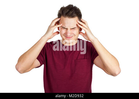 Picture of stressed young man having a bad headache on isolated background - Stock Photo