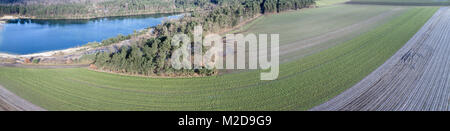 Aerial landscape photo, aerial photo with a lake, fields, meadows, forests and a road, panorama as a banner for - Stock Photo
