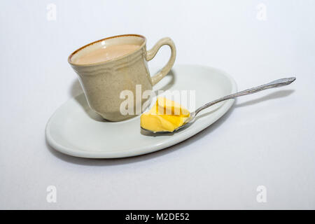 Ketogenic bulletproof coffee with butter for weight loss program and fat intake - Stock Photo