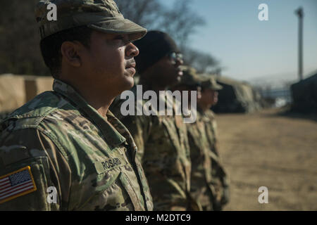 U.S. Army Soldiers, assigned to Bravo Company, 304th Expeditionary Signal Battalion, 1st Signal Brigade, stands - Stock Photo