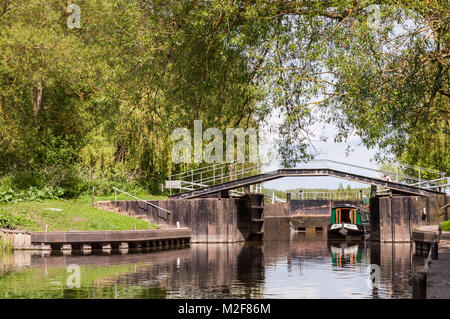 A double lock on the River Avon near Stratford-upon-Avon with a narrowboat in the locks on a sunny Spring day, Warwickshire - Stock Photo
