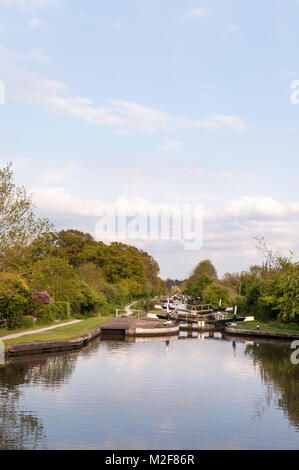 View down the flights of Hatton Locks on the Grand Union Canal on a sunny Spring afternoon, Warwickshire, United - Stock Photo