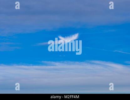 Tissington Village, Derbyshire. 7th Feb, 2018. UK Weather: Unusual strange bizarre looking whispery cloud formation - Stock Photo