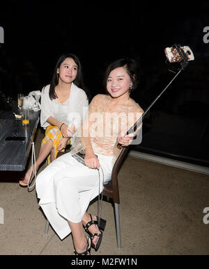 Young Chinese women tourists taking a selfie, Australia - Stock Photo