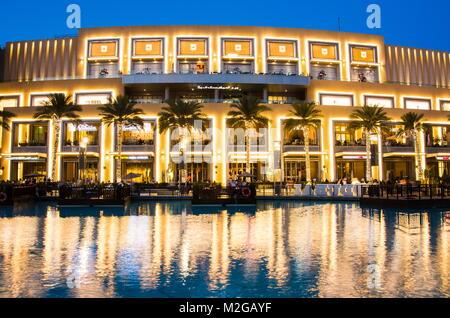 DUBAI, UNITED ARAB EMIRATES - FEBRUARY 5, 2018: Dubai mall modern architecture reflected in the fountain at blue - Stock Photo