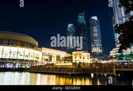 DUBAI, UNITED ARAB EMIRATES - FEBRUARY 5, 2018: Dubai mall building and neighboring skyscrapers reflected in the - Stock Photo