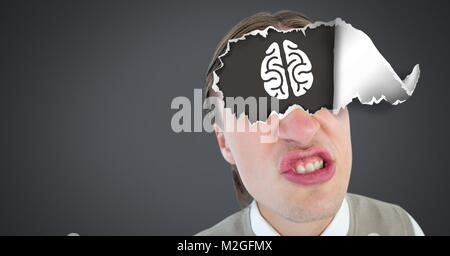 Man with torn paper on eyes and brain - Stock Photo