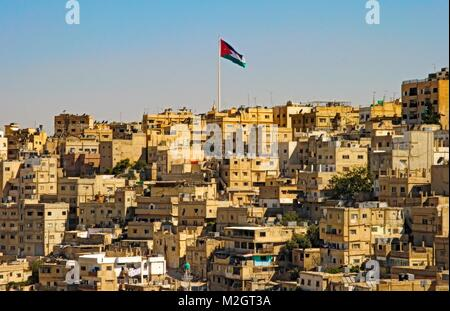 Amman city view with big Jordan flag and flagpole, City of Amman, Jordan - Stock Photo