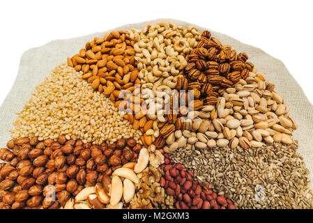 Nuts mix in a canvas bag in table. - Stock Photo
