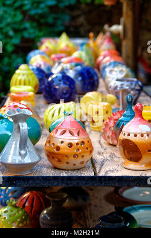 Handmade traditional ceramic candle holders on the table in a souvenir shop in Chania, Crete. - Stock Photo