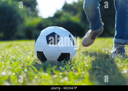Close up of ball lying in grass - Stock Photo