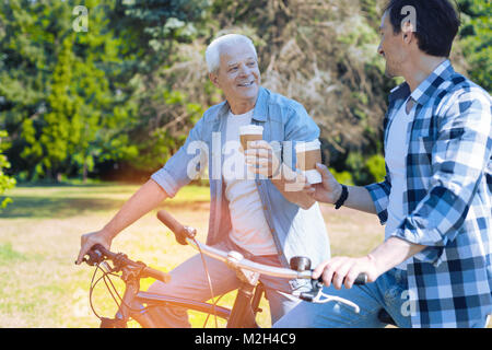 Relaxed father and son spending time together - Stock Photo