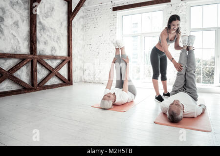Active retired people attending fitness club - Stock Photo