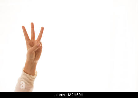 A hand sign indicating the number three - Stock Photo