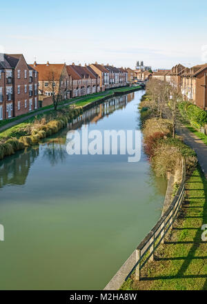 View along the canal flanked by town houses and the ancient Minster on a bright calm morning in Beverley, Yorkshire, - Stock Photo