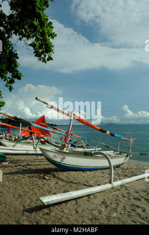 traditional fishing boats Jukung on beach in Lombok, Indonesia - Stock Photo