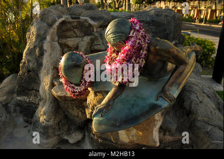 Makua and Kila statue, seal and surfer, Waikiki, Honolulu, Hawaii, USA - Stock Photo