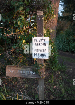 black and white private garden private parking sign; essex; england; uk - Stock Photo