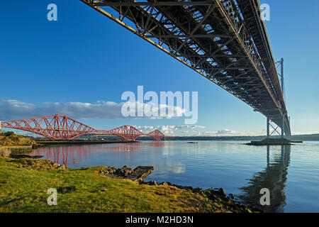 Forth Road Bridge and Forth Rail Bridge from North Queensferry, Fife, Scotland. - Stock Photo